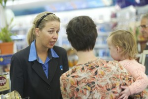 Artz and Kay pharmacy - candid pics of staff with customers for ad.060411GW12